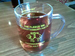 Glass tankard commemorating the second anniversary of The Fleece Inn as a community-run pub