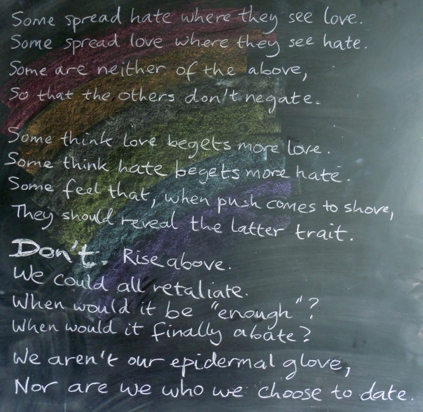 A poem on a chalkboard, on a rainbow background. Text given in image description.
